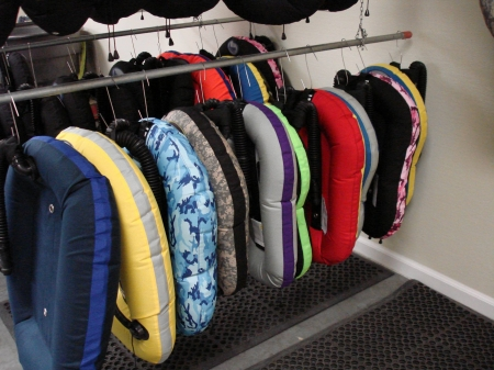 Various wing sizes and types hanging in QC at Halcyon Dive Systems
